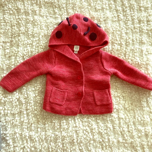 SALE ITEM A single Baby Hoodie with front zip in Fuchsia Pink size 6-12 Months